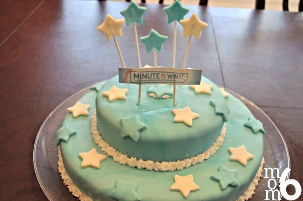 """Fantastic ideas for hosting a Minute to Win It birthday party at home! This post includes ideas for Minute to Win It party games (with links to the """"blueprints"""") and prizes, and lots of tips on how to make your Minute to Win it Party awesome!"""