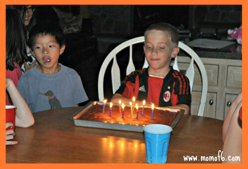 After a fun summer that included several family camping trips, our son knew exactly what he wanted to do with his friends to celebrate his 9th birthday- a backyard campout birthday party sleepover! This post give you all of the details on how to play your own party!
