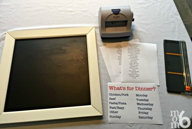 """I have been using a magnetic menu planning board for years now. I love how it makes the actual menu planning process so simple- all I have to do to pick and choose family dinners from my list and just move them into their daily spot. No more answering the question, """"What's for Dinner?""""- my kids know exactly where to look!"""