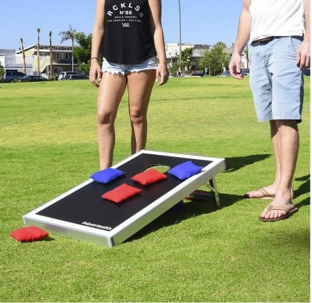 """If you're like me, you'll chase your kids """"outside to play"""" about 4,927 times this summer! So why not make sure that they have some awesome backyard games just waiting to be played with?"""