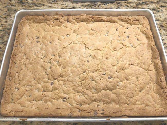 I love these chocolate chip cookie bars because you just pat the dough into the pan to bake- nothing to roll into balls or cut out with cookie cutters. We prefer to make a triple batch of the dough and then divide it up to make chocolate chip cookie bars, butterscotch chip cookie bars, and plain cookie bars (without chips).