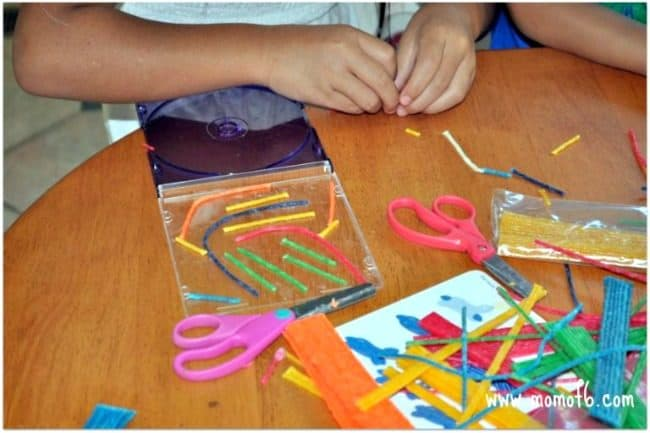Here's how to make a CD Case Maze with your kids! Kids love to do mazes, and 3D mazes where you try to move a marble through the pathways are even better! This is a super easy craft for kids made from plastic CD cases and waxed sticks!
