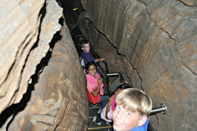 Mammoth Cave National Park is the world's longest cave system- and makes for a fantastic family road trip destination! Here are 5 reasons to visit Mammoth Cave with kids!