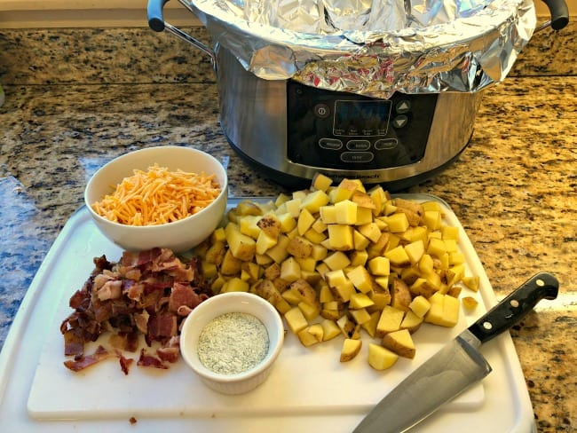Whether we are grilling steaks outside or simmering a roast in the oven, nothing pairs better than something warm and cheesy- with bacon! Give these super-easy, 4-ingredient, slow cooker cheesy potatoes a try!