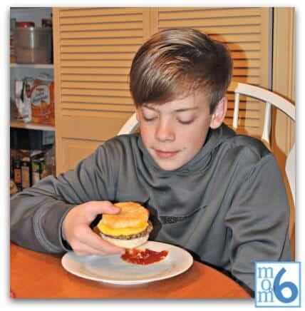 Spencer w breakfast sandwich