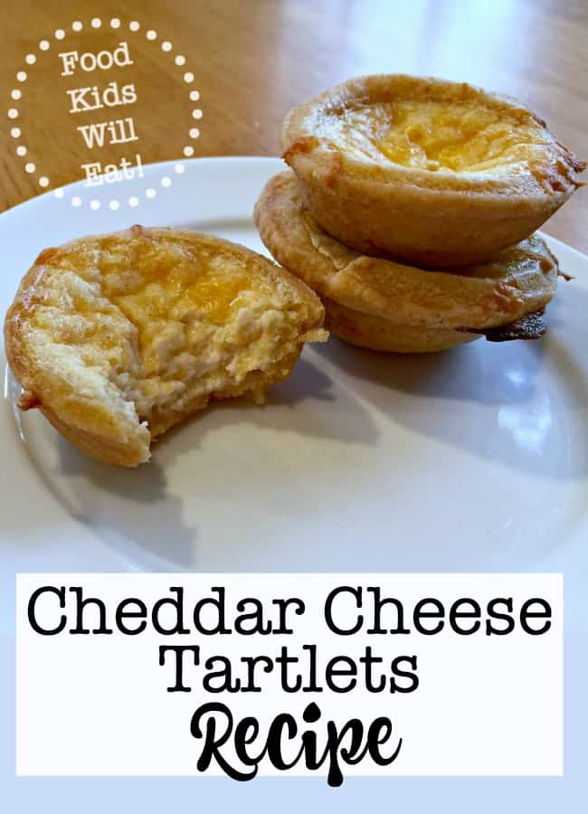 These cheddar cheese tartlets are constructed out of a cheddar-cheese dough and then filled with a creamy cheese filling, and then topped with shredded cheddar before baking. Yum! They make the perfect appetizer for the holidays!