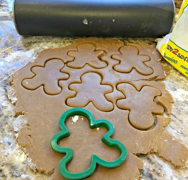 These gingerbread men cookies are chewy, have all of the deep rich molasses flavor that we love in gingerbread cookies, and when paired with fiery red hot eyes and buttons- they are just the perfect combination of holiday cookie goodness!