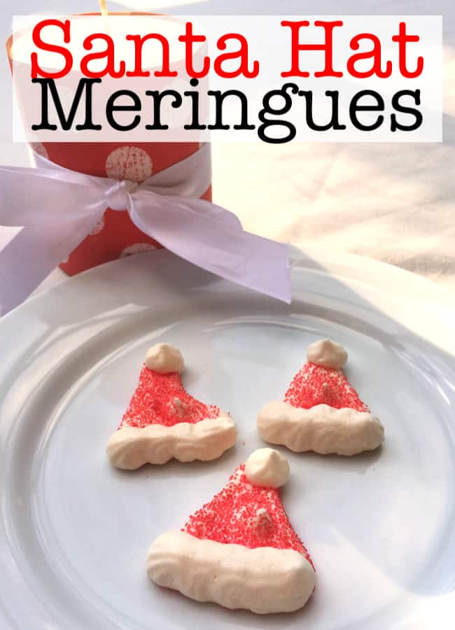 These Santa hat meringue cookies are absolutely adorable to look at and are hands-down my kids' favorite holiday cookie! They are crispy on the outside but they melt in your mouth just like cotton candy!