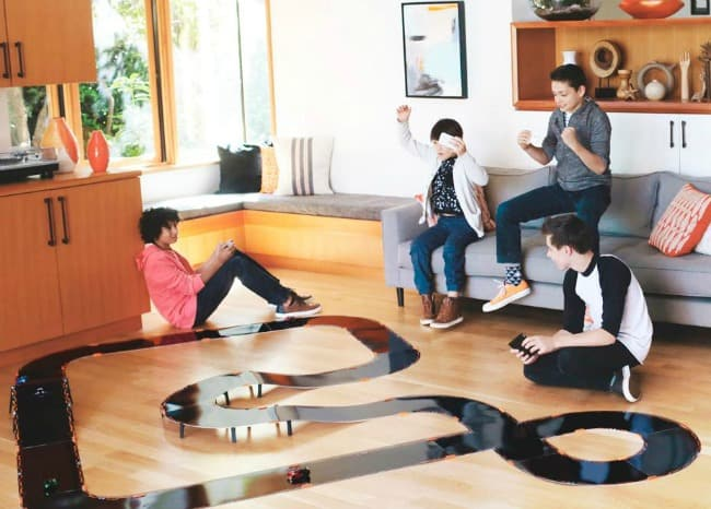 This race car birthday party takes the best part of a slot car racing venue- where kids get to choose their car and participate in planned races against their friends on a huge elevated track that twists and turns around the room! And the best part is- they get to keep the race track when the party is over!