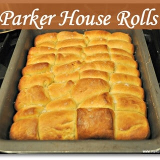 These Parker House rolls are simply decadent. According to Wikipedia, Parker House rolls were invented at the Parker House Hotel in Boston during the 1870's, most likely created by an angry cook throwing unfinished rolls into the oven which resulted in their dented appearance.
