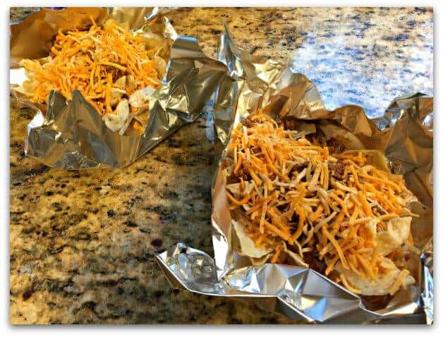 Foil Packet Grilled Taco Nachos made on the grill! Preparing them in a foil packet and then grilling them adds a delicious smoky flavor to the nachos! You gotta give it a try!