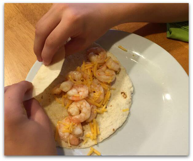 This recipe for Foil Packet Grilled Shrimp Fajitas is super simple to prepare- the kids can literally do it themselves- and has become one of our family's favorites!