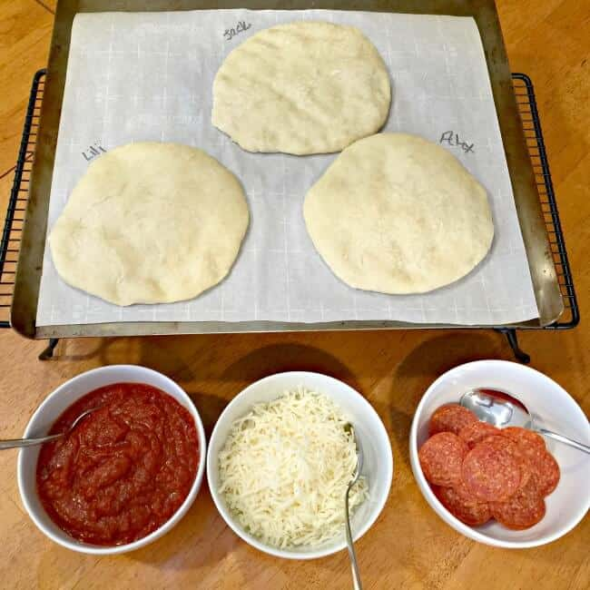 When I have the time, I love making pizza at home vs. ordering out for delivery. Especially when I can get my kids involved in make your own mini pizzas for dinner! The pizza dough comes together quickly and doesn't require time to rise, so you don't need to remember to start in advance (bonus!). And since this recipe makes enough for 12 mini pizzas- it's perfect for play dates or birthday parties too!