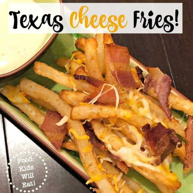 One of our favorites restaurant side dishes is Texas Cheese Fries- which is a delicious marriage of crispy french fries covered in melted cheese, topped with chopped bacon, and served with ranch dip! We've found a way to recreate this dish at home, using our air fryer- which cuts back on the fat and calories since we don't use any oil!