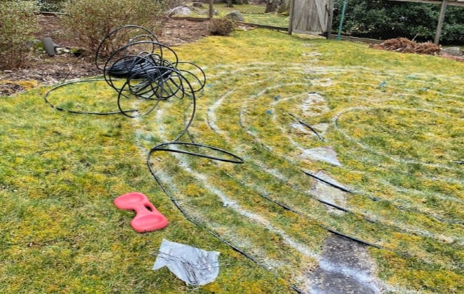 Using black plastic tubing for building a backyard labyrinth